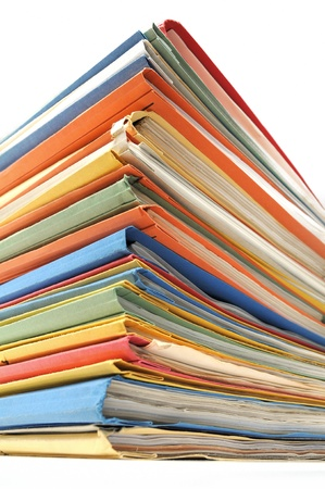 data storage: Stack of multicolored folders with documents on white background  Stock Photo