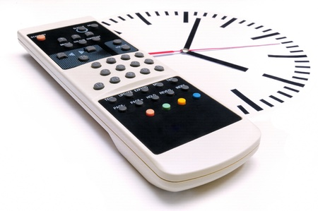 TV Remote Control and clock on white background  photo