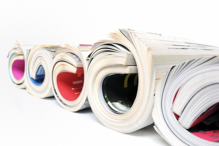 print media: Five rolled up magazines over white background