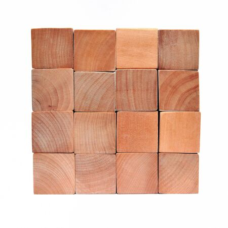 Cube of natural colored toy blocks on white background  photo