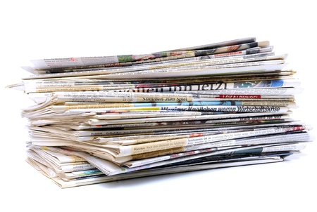 Pile of newspapers over white background