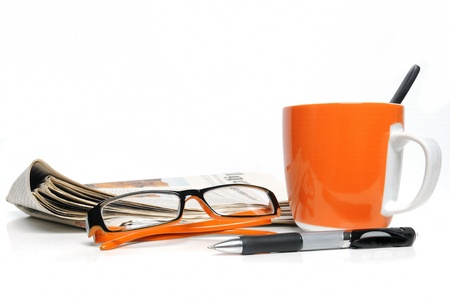 capuchino: Newspaper, glasses, cup of coffee and ballpoint on white background