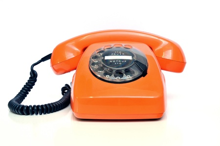 Retro telephone orange on white background photo