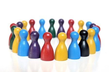 finance director: Discussion forum of multicolored toy figures on white background Stock Photo