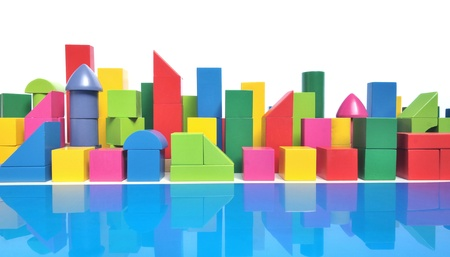 tower block: Urban city skyline with multicolored toy blocks on white background Stock Photo