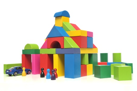 kindergarten toys: House of multicolored toy blocks on white background