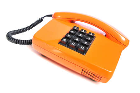 Orange colored retro telephone with phone keypad and receiver on white background  Stock Photo - 12719501