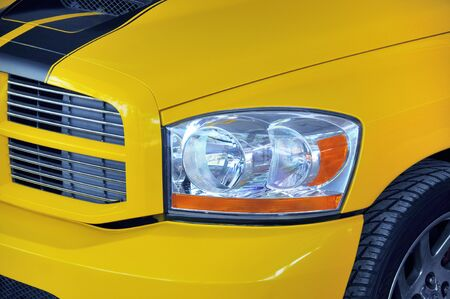 Detail of a yellow colored sports car photo