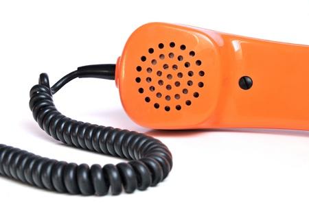 Retro telefoon hoorn oranje op een witte achtergrond Stockfoto