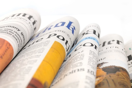 Various newspapers over white background Stock Photo - 12934359