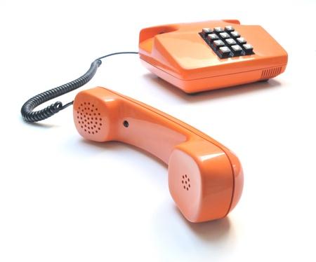 Retro telephone orange on white background  photo