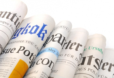 articles: Various newspapers over white background