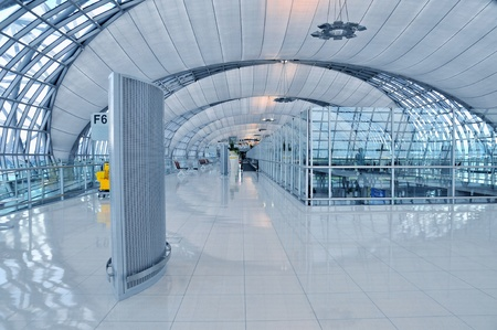 Architecture detail of a corridor with walkway inside departure terminal of Bangkok Airport in Thailand