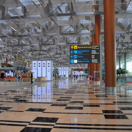 Airport scene of Terminal 3 of Changi Airport in Singapore - Travellers relaxing and waiting for check-in