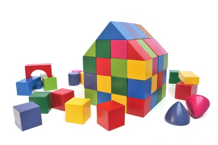 toy blocks: House of multicolored toy blocks on white background
