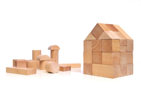 construction house: Little town house of natural colored toy blocks on white background  Stock Photo