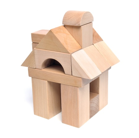 wood blocks: Little weekend house with natural colored toy blocks on white background