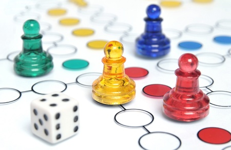 Ludo game with multicolored glass figures