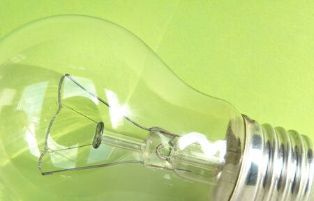 green power: Light bulb in front of green background - Symbol for green power  Stock Photo