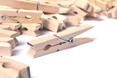 clothes pegs: Wooden clothes pegs on white background
