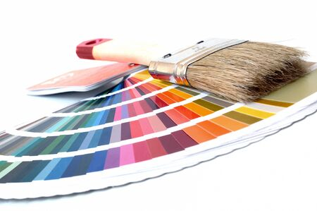 Color chart with paint brush on white background  photo