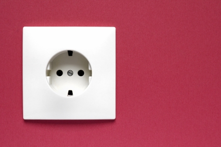 White power socket on a red wall  photo