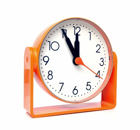 five to twelve: Orange clock shows five minutes to twelve