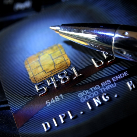 ball pen: Black credit card with ball pen on top Stock Photo