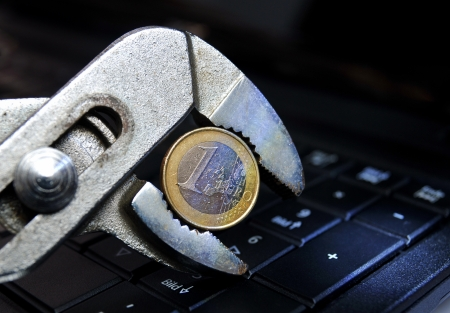 Euro crisis, money coin in a water pump pliers  photo
