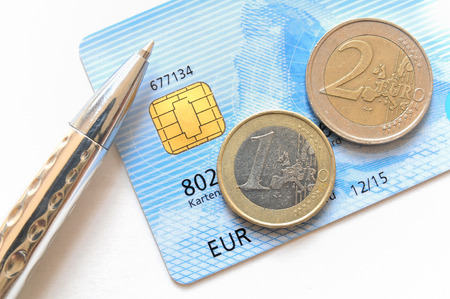 pocket book: Euro coins on top of a credit card