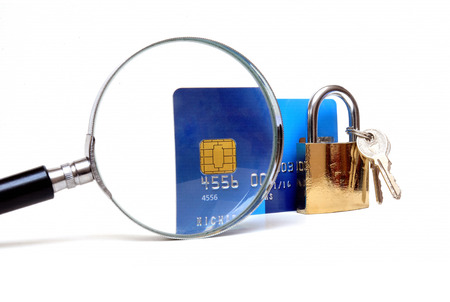 Secure banking and online shopping, credit card and padlock with magnifying glass  photo