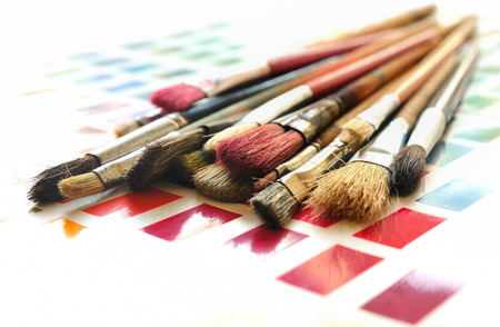 Artist paintbrushes on a color swatch  photo