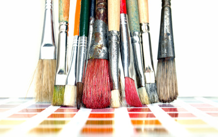 design tools: Artist paintbrushes on a color swatch