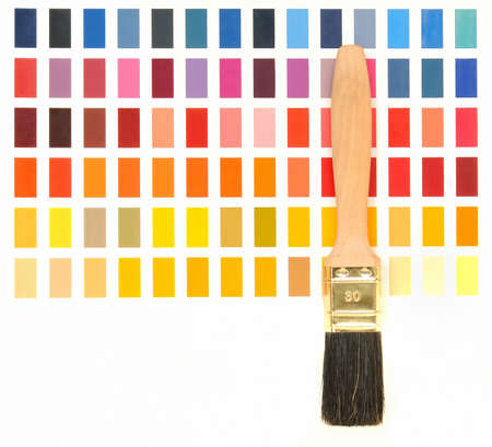 Wooden paint brush in front of a color chart  photo