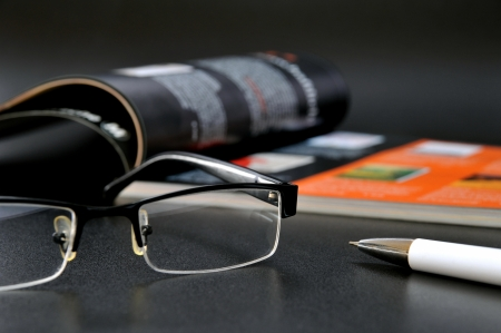 ball pen: Magazine with glasses and ball pen
