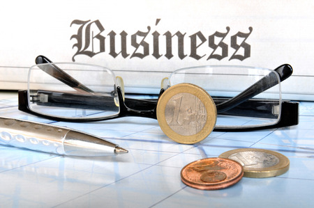 Business Still Life, money coins with ball pen and glasses  photo
