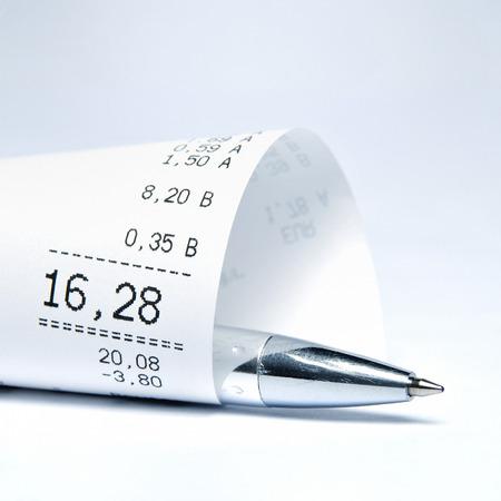cash receipt: Supermarket receipt and ball pen