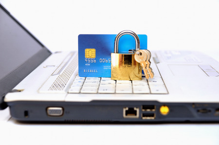 Credit Card Security, credit card and padlock on a laptop  photo