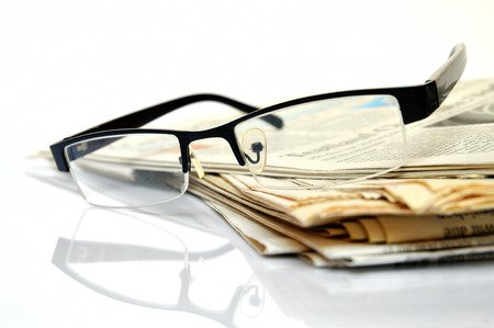 International News, newspapers with black glasses on top  Stock Photo - 24829552