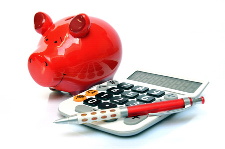 sales bank: Red piggy bank with calculator and ball pen  Stock Photo