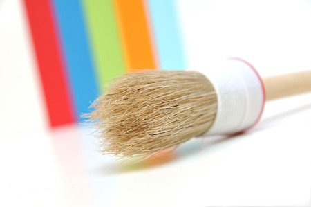 Paintbrush in front of color scheme  photo