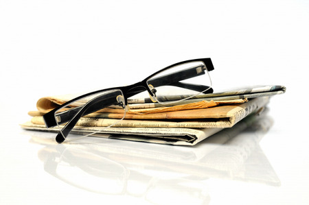 breaking news: Breaking news, stack of newspapers with glasses on top