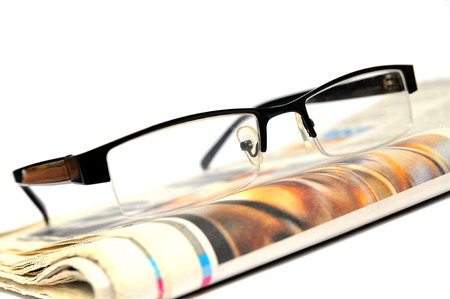 Black glasses on a newspaper  photo