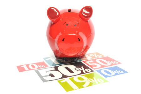 rewards: Saving money - red piggy bank with multicolored newspaper percentage adverts