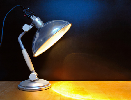 lamp: Vintage lamp in front of black wall Stock Photo