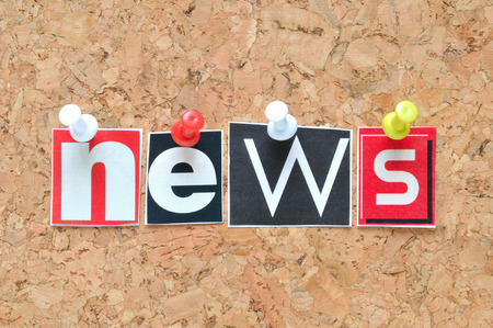 News lettering on cork background photo