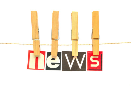 News in wooden clothes peg photo