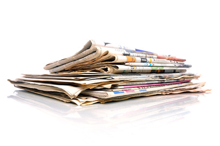 Small stack of newspapers photo