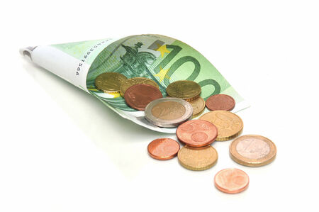 tax tips: Monthly income - 100 Euro banknote with coins