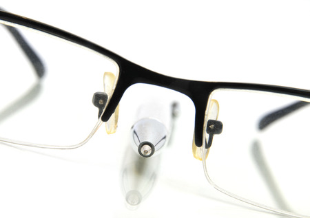 formal dressing: Black nerd glasses with ballpoint pen Stock Photo